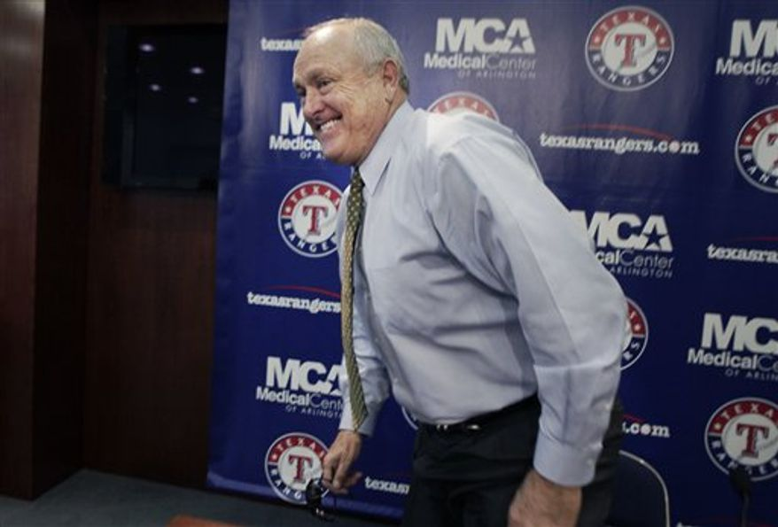 Texas Rangers president Nolan Ryan smiles after concluding a news conference in Arlington, Texas, Thursday, Aug. 5, 2010. The Rangers exited federal bankruptcy protection on Thursday, little more than 12 hours after Hall of Fame pitcher Ryan's group bought the team at a marathon auction. Major League Baseball is expected to formally approve Ryan and sports attorney Chuck Greenberg as the team's new owners next week. (AP Photo/LM Otero)
