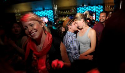 Lauren von Koss, right, and girlfriend Kade Bailey celebrate in the Castro district of San Francisco following a federal judge's decision to overturn California's same-sex marriage ban on Wednesday, Aug. 4, 2010. (AP Photo/Noah Berger)