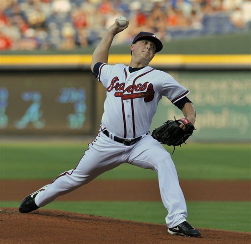 Atlanta Braves starter Kris Medlen delivers to the New York Mets during the second inning of a baseball game Wednesday, Aug. 4, 2010, at Turner Field in Atlanta. (AP Photo/Gregory Smith)