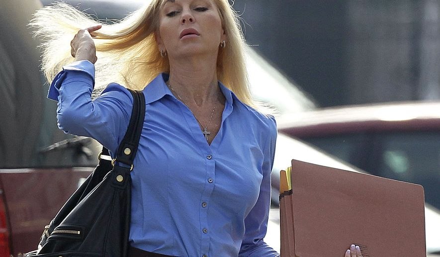 ** FILE ** Karen Cunagin Sypher arrives at the federal courthouse in Louisville, Ky., on Tuesday, July 27, 2010, for the second day of her trial. Sypher was convicted Thursday of trying to extort money from Louisville basketball coach Rick Pitino. (AP Photo/Ed Reinke)