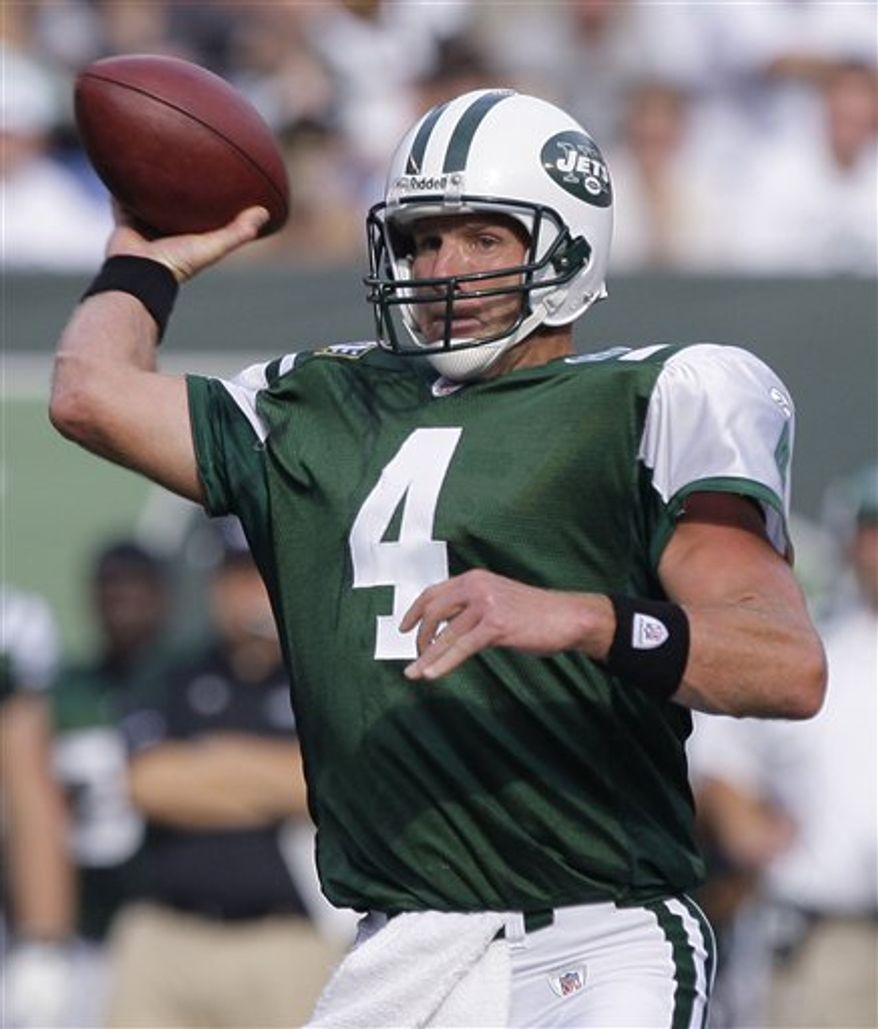 FILE - This Sept. 14, 2008, file photo shows New York Jets quarterback Brett Favre throwing a pass against the New England Patriots during the first quarter in an NFL football game, in East Rutherford, N.J. A person with knowledge of the situation told The Associated Press on Tuesday, Aug. 3, 2010,  that Favre has informed the Vikings he won't return for a second season.  (AP Photo/Julie Jacobson, File)