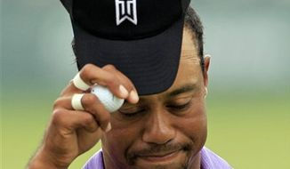 Tiger Woods watches a missed putt on the second green during the fourth round of the Bridgestone Invitational golf tournament at Firestone Country Club in Akron, Ohio on Sunday, Aug. 8, 2010.  (AP Photo/Amy Sancetta)