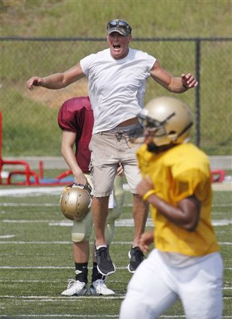 Minnnesota Vikings quaterback Brett Favre makes a touchdown signal as he returns to the practice field for the first time during NFL football training camp, Wednesday, Aug. 18, 2010 in Eden Prairie, Minn. After staying away from training camp, Favre was practicing less than 24 hours after the team sent three of his closest friends to Mississippi to bring him back following another summer of indecision.  (AP Photo/Jim Mone)