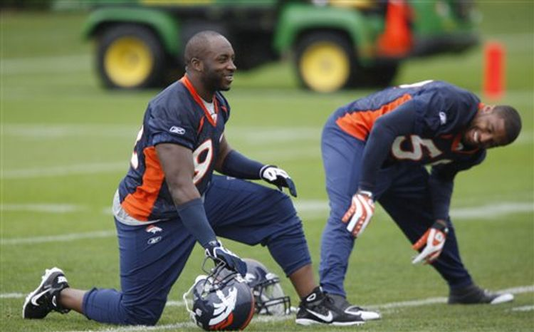 FILE - This May 1, 2009, file photo shows Denver Broncos football player  Elvis Dumervil.  NFL sacks king Elvis Dumervil might miss the season with a torn chest muscle. A person familiar with the injury to Dumervil told The Associated Press the Denver Broncos pass rusher has torn his pectoral muscle and could be sidelined up to five months. (AP Photo/File)