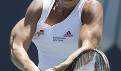 Agnieszka Radwanska, of Poland, flips her racket after missing a shot against Daniela Hantuchova, Slovakia, during the Mercury Insurance Open tennis tournament in Carlsbad, Calif., Saturday, Aug. 7, 2010. (AP Photo/Chris Carlson)