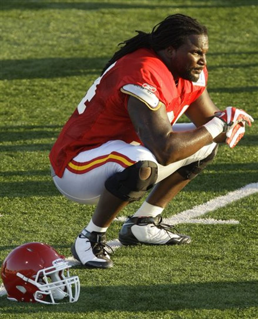 Kansas City Chiefs defensive end Tyson Jackson stretches during NFL football training camp in St. Joseph, Mo., Wednesday, Aug. 4, 2010. (AP Photo/Orlin Wagner)