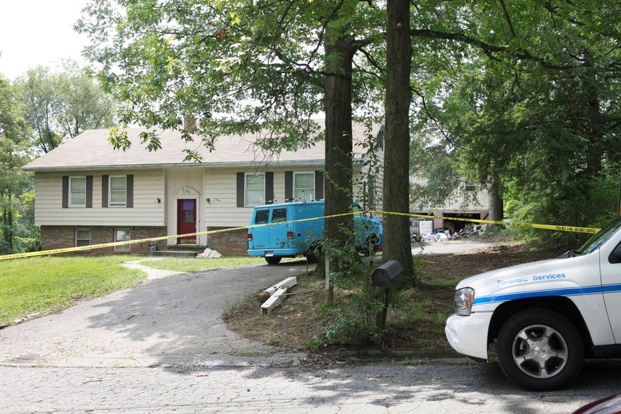 A home in Lanham, Md., Friday, Aug. 6, 2010, where the bodies of two women and two children were found dead. (AP Photo/Jacquelyn Martin)