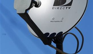 FILE - In this Feb. 10, 2009 file photo, a DirecTV satellite receiver dish is seen on a home in Simi Valley, Calif.  DirecTV said Thursday, Aug. 5, 2010, its second-quarter profit rose 33 percent, helped by higher prices for programming packages. (AP Photo/Reed Saxon, file)