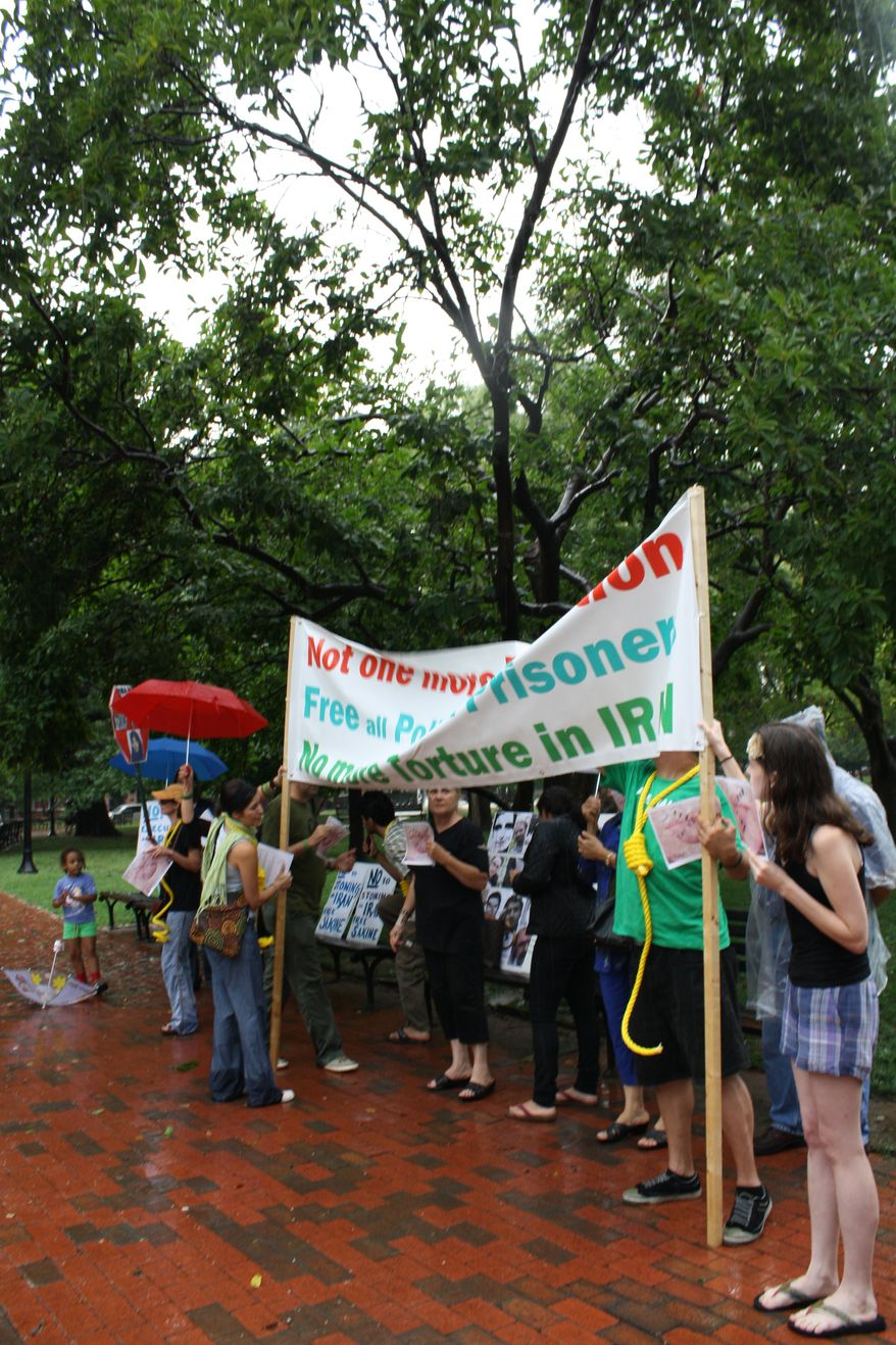 Rainy weather didn't deter a group of about 15 Iranian activists, shown in front of the White House in Lafayette Park on Thursday, August 5, 2010, from protesting the regime's execution and torture of political prisoners.