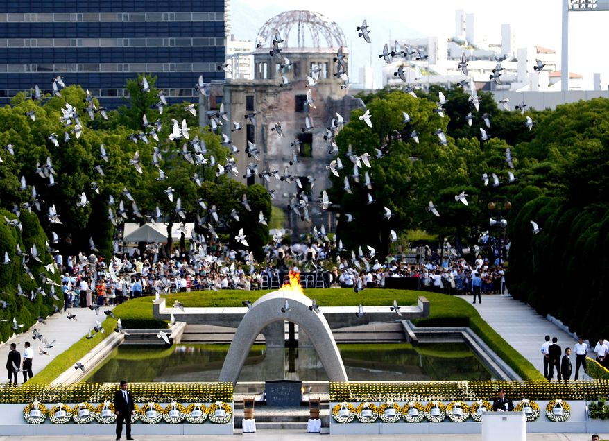 With the gutted Atomic Bomb Dome as a backdrop, doves fly over the cenotaph of the Peace Memorial Park at Hiroshima, western Japan, Friday, Aug. 6, 2010. Hiroshima marked the 65th anniversary of the the world's first atomic bomb attack that devastated the western Japanese city at the closing days of World War II. (AP Photo/Shuji Kajiyama)