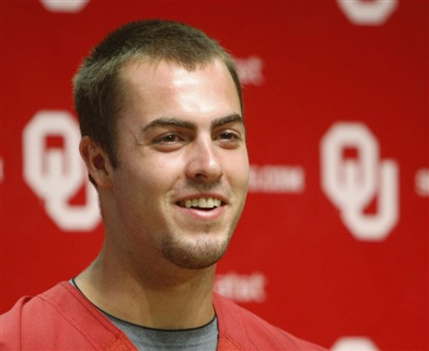 Oklahoma offensive coordinator Kevin Wilson gestures as he answers a question during a news conference at NCAA college football media day in Norman, Okla., Friday, Aug. 6, 2010. (AP Photo/Sue Ogrocki)