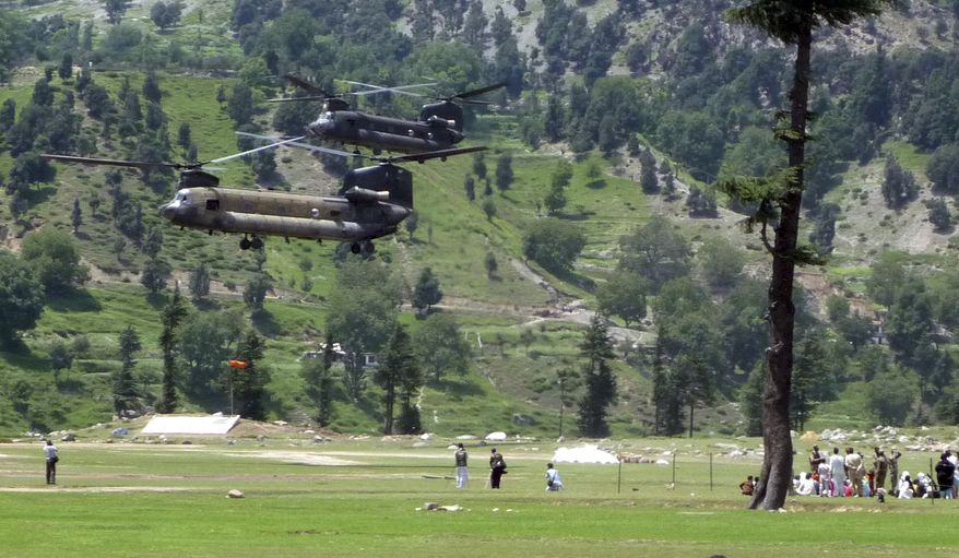 U. S. Chinook helicopters arrive in Kalam, Pakistan to evacuate stranded tourists on Thursday, Aug. 5, 2010.The floods have already killed an estimated 1,500 people over the past week, most of them in the northwest, the center of Pakistan's fight against al-Qaida and the Taliban. An estimated 4.2 million Pakistanis have been affected, including many in eastern Punjab province, which has seen numerous villages swallowed by rising water in recent days. (AP Photo/Sherin Zada)