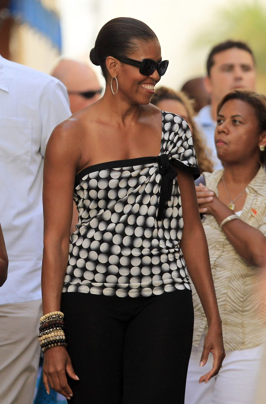 First lady Michelle Obama smiles while she visits Marbella, southern Spain on Aug. 4, 2010, during a private vacation with daughter Sasha. (Associated Press)