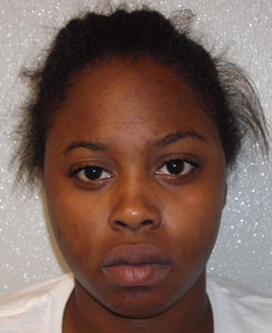 This undated booking photo released by the Prince George's County Police shows 18-year-old Tkeisha Nicole Gilmer, of Texas City, Texas. Gilmer and 43-year-old Darrell Lynn Bellard, of Dickinson, Texas, have each been charged with murder in the slayings of two women and two children found in a trash-filled apartment in the Washington area. (AP Photo/Prince George's County Police)