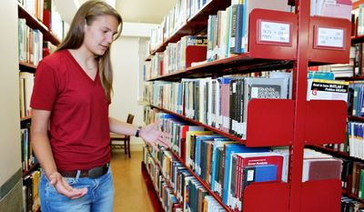 Brittany Wolfe had to play an infuriating game of checking out books on reserve to avoid having to buy them herself when she was an undergraduate at the University of California, Los Angeles. Now she is giving advice on textbooks as part of her work as an orientation counselor. (Associated Press)