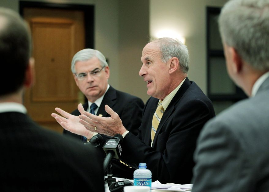 ASSOCIATED PRESS Dan Coats, Republican nominee for U.S. Senate (right center), speaks with health care professionals during a roundtable discussion on health care at St. Francis Hospital in Indianapolis on Tuesday.