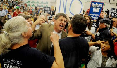 The Washington Times Pro-lifer Randall Terry, founder of Operation Rescue, gets into a shouting match over health care legislation at an August 2009 town-hall meeting held by Rep. James P. Moran, Virginia Democrat, in Reston, Va. A year later, both sides are still shouting.