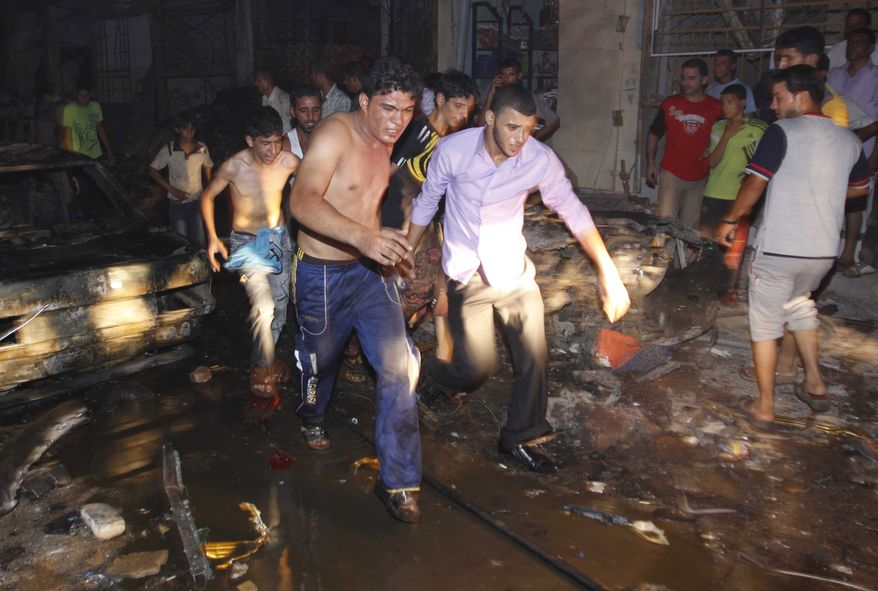 Iraqis evacuate a victim from the scene of an explosion in Basra, Iraq's second-largest city, 340 miles southeast of Baghdad, on Saturday, Aug. 7, 2010. (AP Photo/Nabil al-Jurani)