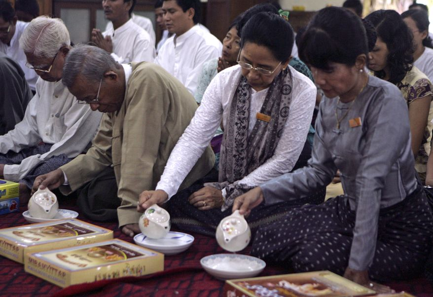 Former student activists and pro-democracy politicians hold a quiet religious ceremony at a Buddhist monastery in an eastern suburb of Yangon, Myanmar, on Sunday, Aug. 8, 2010, to mark the anniversary of the 1988 uprising that was brutally crushed by Myanmar's military. More than a million people rose up Aug. 8 that year to protest an entrenched military-backed regime headed by Gen. Ne Win that had wiped out the savings of many by a sudden demonetization of the currency. (AP Photo/Khin Maung Win)