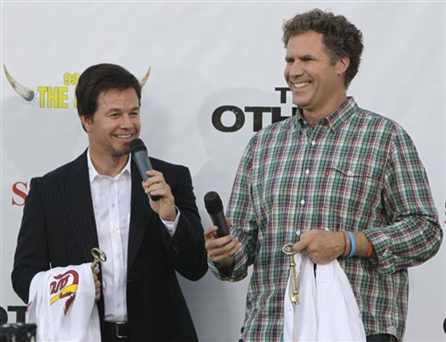 """Actors Mark Wahlberg, left, and Will Ferrell laugh as they speak to a large crowd gathered for a premiere of their new movie """"The Other Guys"""" at Wehrenberg Chesterfield Galaxy theater Thursday, Aug. 5, 2010, in Chesterfield, Mo. The St. Louis area was picked to host the event as a result of fan voting on Facebook. (AP Photo/Jeff Roberson)"""