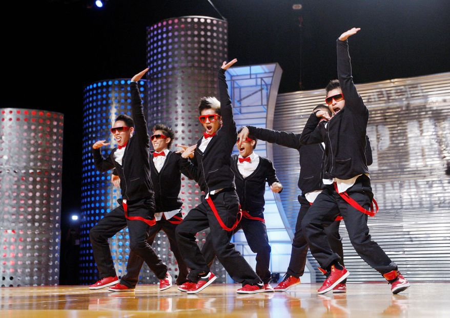 "The dance team Poreotics performs during the World Hip Hop Dance Championships in Las Vegas last week. The two-time U.S. hip-hop dance champs used their stationary, robotic style and stage humor to win on ""America's Best Dance Crew,"" a show on MTV. (Associated Press)"