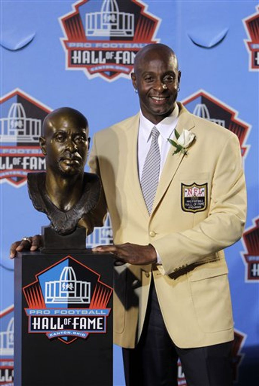 Former San Francisco 49ers great Jerry Rice poses with his bust after enshrinement in the Pro Football Hall of Fame in Canton, Ohio Saturday, Aug. 7, 2010. (AP Photo/Mark Duncan)