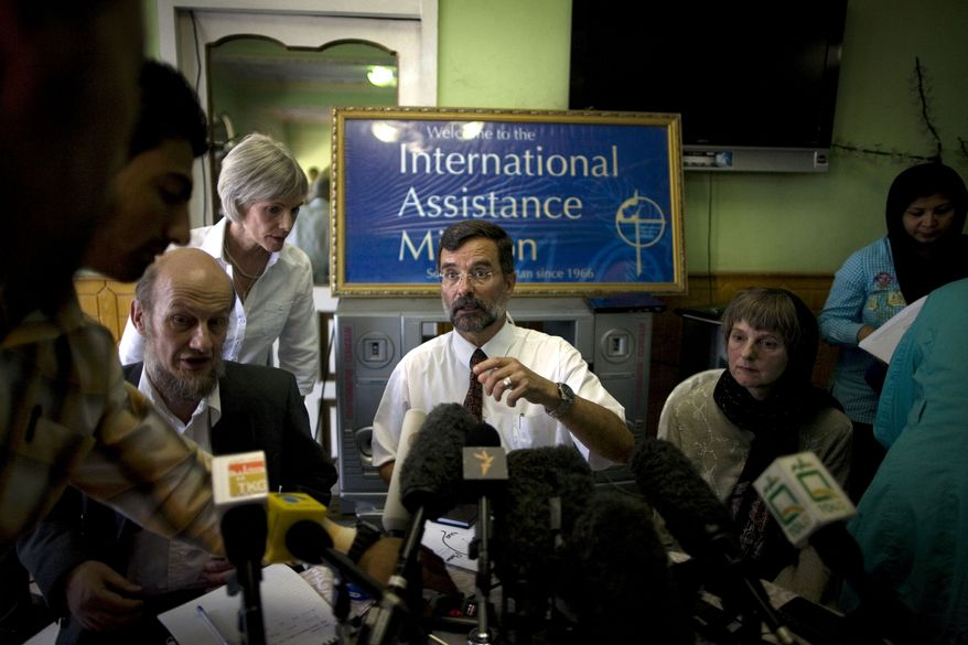 Dirk Frans (center), director of the International Assistance Mission, talks to a journalist during a press conference in Kabul, Afghanistan, on Monday, Aug. 9, 2010. The Christian charity said it had no plans to leave Afghanistan despite the murders of 10 members of its medical aid team, and it repeated that the organization does not attempt to convert Muslims to Christianity. (AP Photo/Rodrigo Abd)