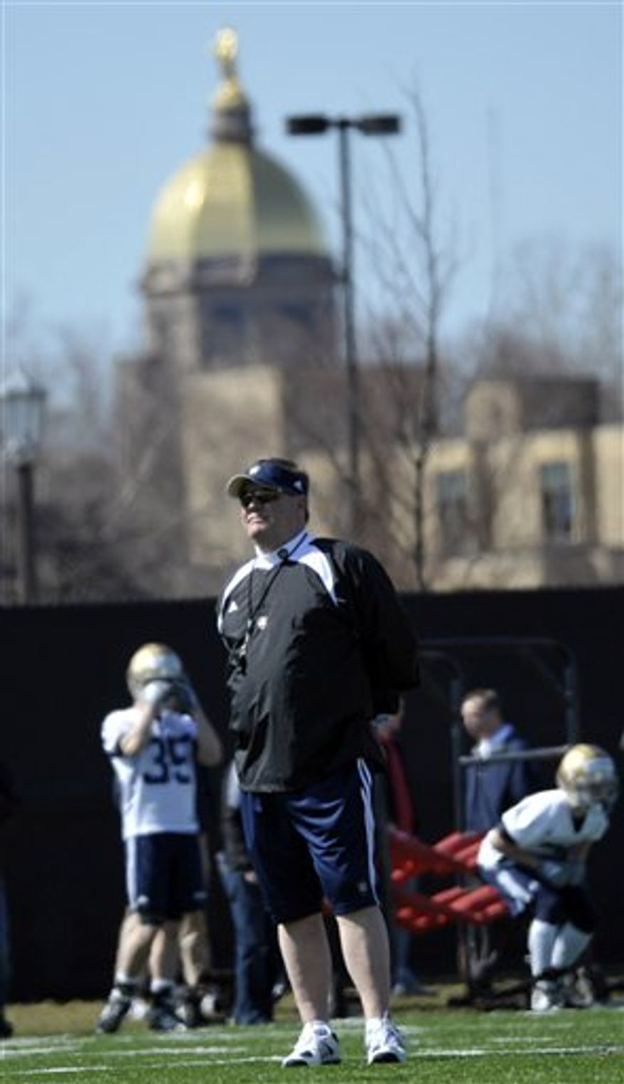 FILE - In this Sept. 4, 2010, file photo, Notre Dame head coach Brian Kelly looks on before an NCAA college football game against Purdue in South Bend, Ind. Spring practice doesn't start until Wednesday, March 23, 2011,  and Kelly already has a big problem. He's suspended his best offensive player, wide receiver Michael Floyd, after he was arrested on a DUI charge, his third run-in with the law over alcohol since 2009.  (AP Photo/Darron Cummings, File)
