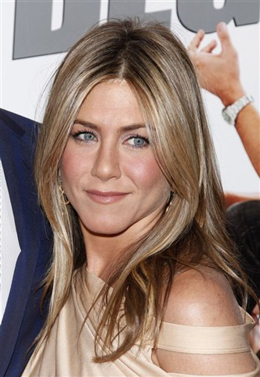 """FILE - In this March 16, 2010 file photo, Jennifer Aniston arrives to the premiere of """"The Bounty Hunter"""" at The Ziegfeld Theater in New York. (AP Photo/Peter Kramer, file)"""