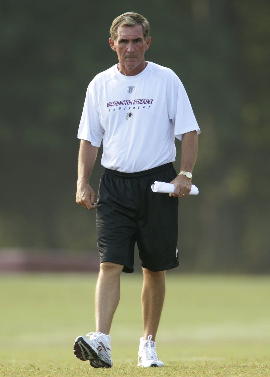 ASSOCIATED PRESS Washington Redskins head coach Mike Shanahan walks the field at the NFL football team's training camp at Redskins Park, Friday, Aug. 6, 2010, in Ashburn, Va.