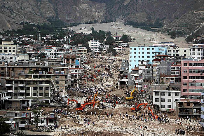 Rescue workers search among the debris after a mudslide swept away a large part of the town of Zhouqu, Gannan prefecture, in northwestern China's Gansu province, on Monday, Aug. 9, 2010. Rescuers dug through mud and wreckage Mo