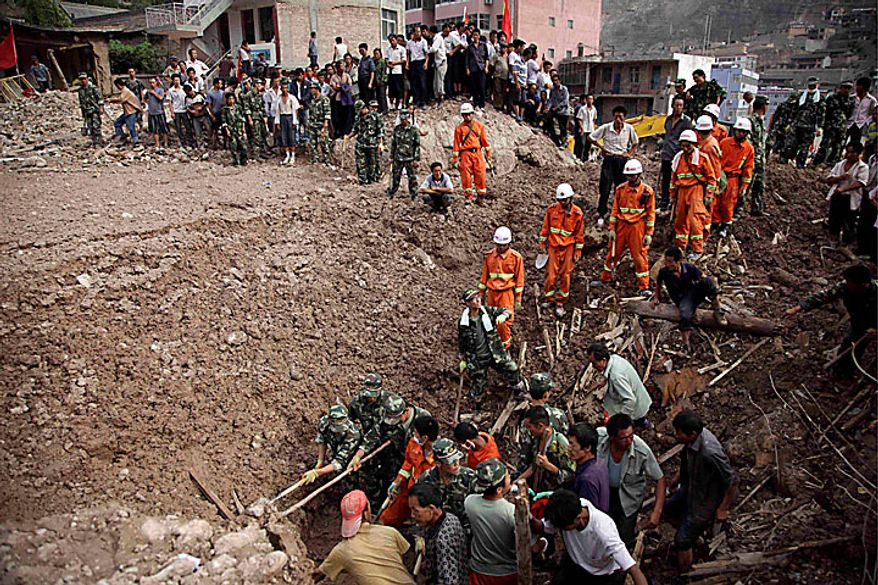 Rescue workers and residents dig through mud to look for bodies in the mudslide-hit town of Zhouqu in Gannan prefecture of northwestern China's Gansu province on Monday, Aug. 9, 2010. (AP Photo/Ng Han Guan)