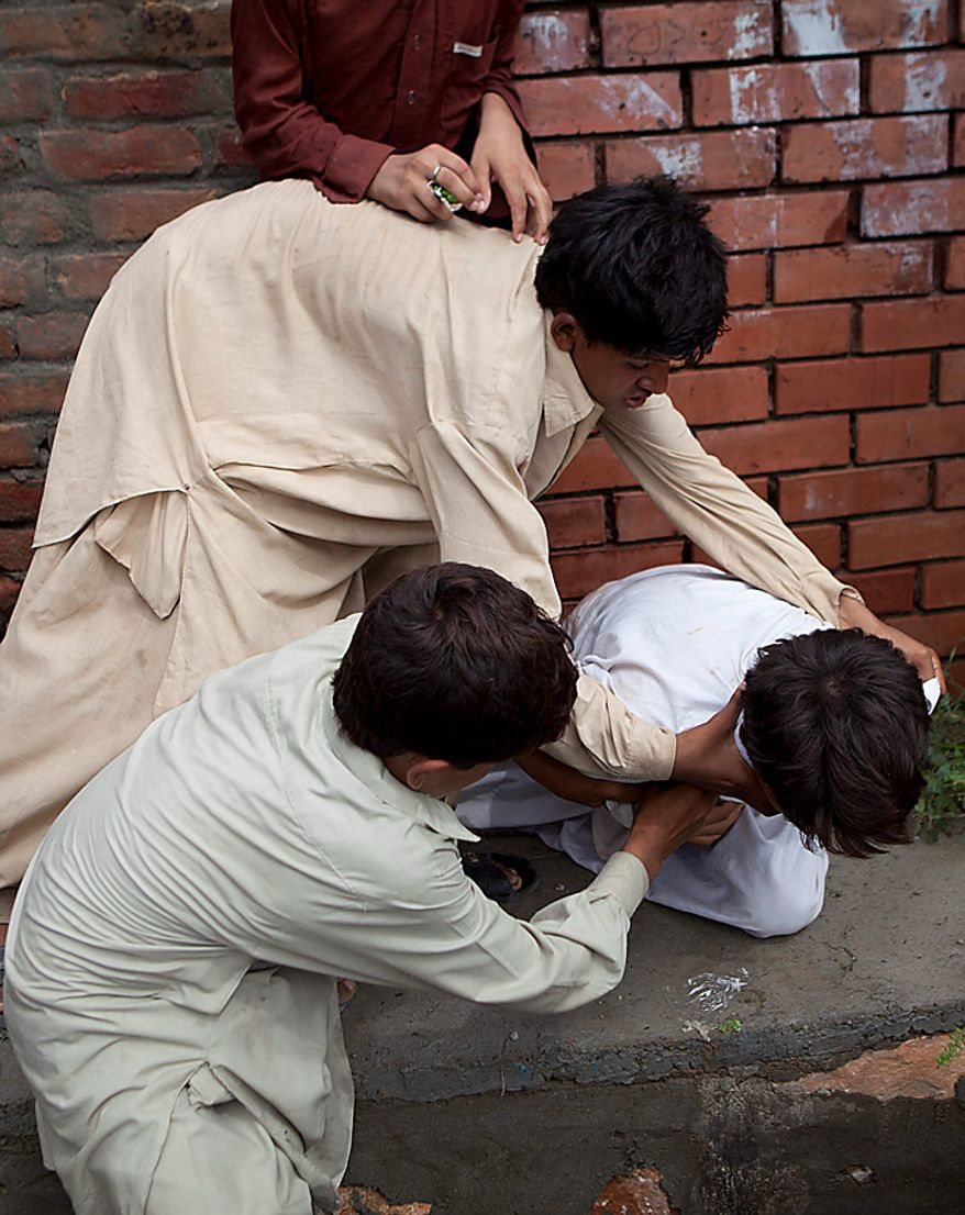 Children scuffle for food relief in Nowshera in northwest Pakistan on Monday, Aug. 9, 2010, in the wake of massive flooding. The number of people suffering from the floods in Pakistan exceeds 13 million -- more than the combined total of the 2004 Indian Ocean tsunami, the 2005 Kashmir earthquake and the 2010 Haiti earthquake, the United Nations said. (AP Photo/B.K.Bangash)