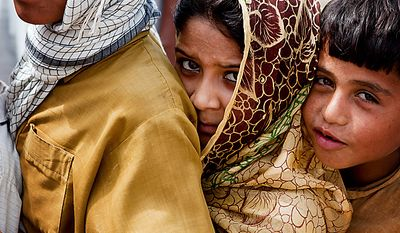 Flood-affected children queue for relief distributed by the Falah-e-Insaniyat foundation, the charity wing of the Pakistani militant group Jamaat-ud-Dawa, in Nowshera, Pakistan, on Monday, Aug. 9, 2010. The number of people suffering from the massive floods in Pakistan exceeds 13 million -- more than the combined total of the 2004 Indian Ocean tsunami, the 2005 Kashmir earthquake and the 2010 Haiti earthquake, the United Nations said. (AP Photo/B.K. Bangash)