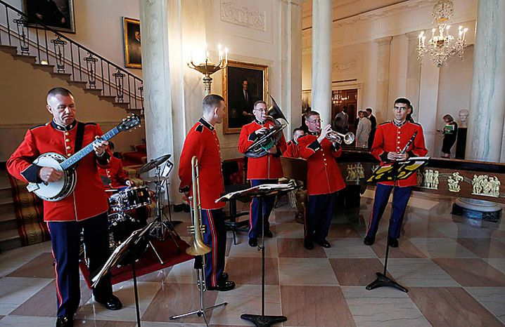 """Members of the U.S. Marine Band, """"The President's Own,"""" play jazz in the Grand Foyer of the White House in Washington on Monday, Aug. 9, 2010, as President Obama honored the New Orleans Saints, the 2009 NFL Super Bowl champions, in the East Room. (AP Photo/Charles Dharapak)"""