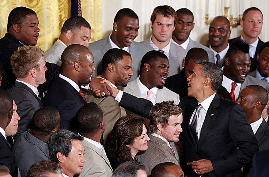 President Obama greets members of New Orleans Saints football team during a ceremony honoring the 2009 NFL Super Bowl champions on Monday, Aug. 9, 2010, in the East Room of the White House in Washington. (AP Photo/Pablo Martinez Monsivais)