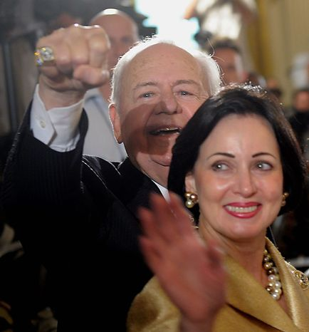 New Orleans Saints owner Tom Benson and his wife, Gayle, arrive in the East Room of the White House in Washington on Monday, Aug. 9, 2010, where President Obama honored the Super Bowl-winning Saints. (AP Photo/Susan Walsh)