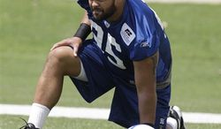 FILE - This June 1, 2010, file photo shows Indianapolis Colts running back Donald Brown during an organized team activity,  in Indianapolis.  Indy's top two picks, Donald Brown and Fili Moala, didn't have the kind of impact that's expected of high draft picks. With a year of experience and lower expectations coming into 2010, both players hope to show last year was a mere aberration. (AP Photo/Michael Conroy, File)