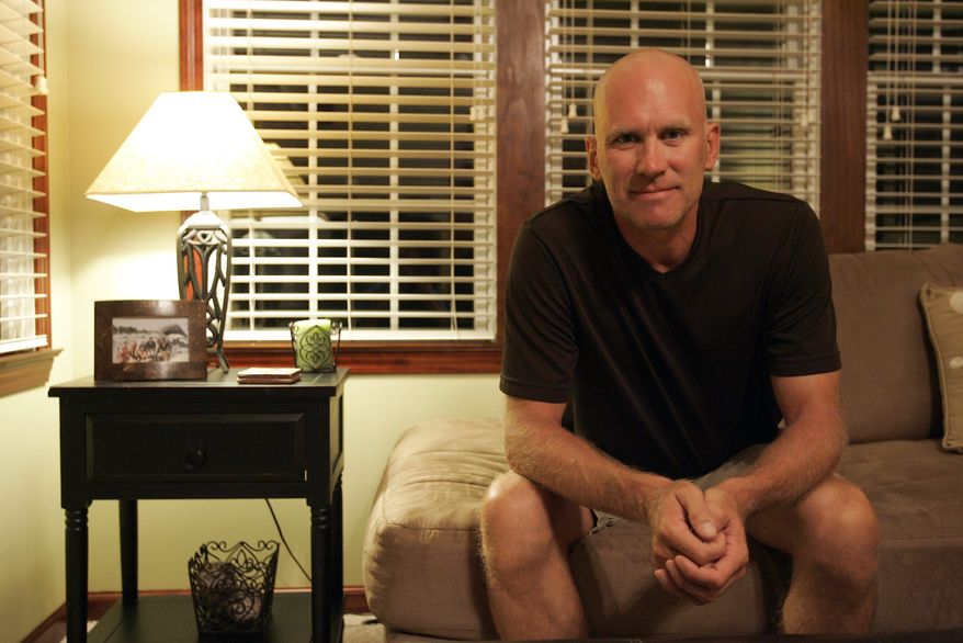 Dave Ebersbach at his home Thursday, Aug. 5, 2010, in Bowling Green, Ohio. Ebersbach, 43, is one of 14 math teachers in the Toledo, Ohio, school district to receive notice a few weeks ago that their jobs were cut. Congress is moving rapidly just weeks before the start of the school year to speed billions of dollars in emergency education aid to states in hopes of reversing the layoffs of tens of thousands of teachers. (AP Photo/J.D. Pooley)