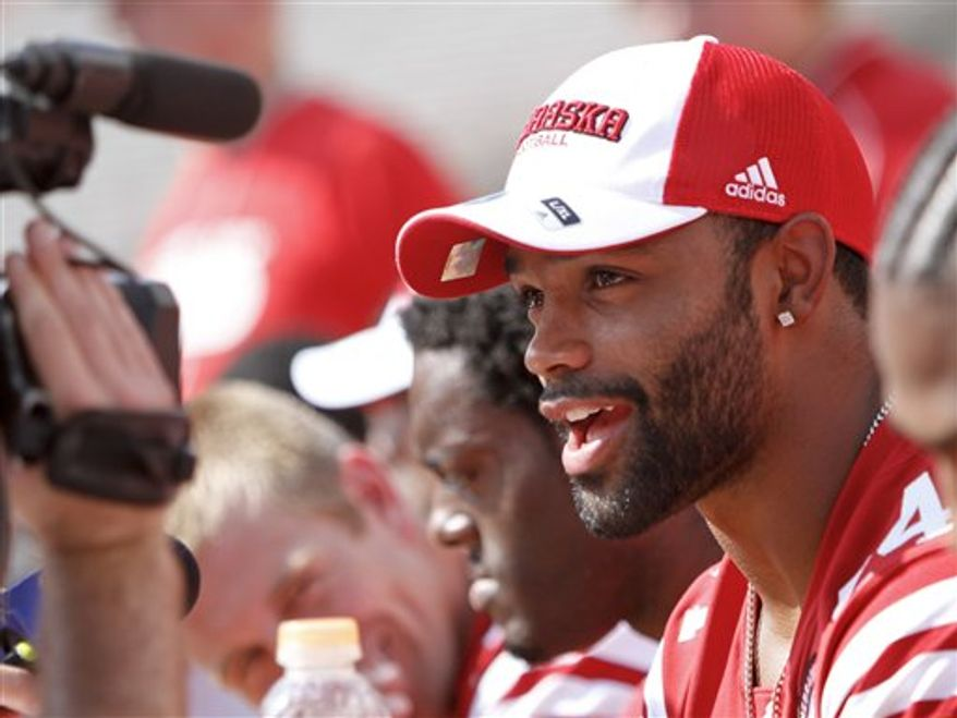 This photo from Aug. 7, 2010 shows Nebraska wide receiver Niles Paul speaking to a camera, during Nebraska's NCAA college football fan day, in Lincoln, Neb. On the day he became old enough to drink legally, Nebraska's Niles Paul apologized Monday, Aug. 9, 2010 for the second of his two alcohol offenses. Paul said he knew he made a mistake, and is trying to move past that.(AP Photo/Nati Harnik)