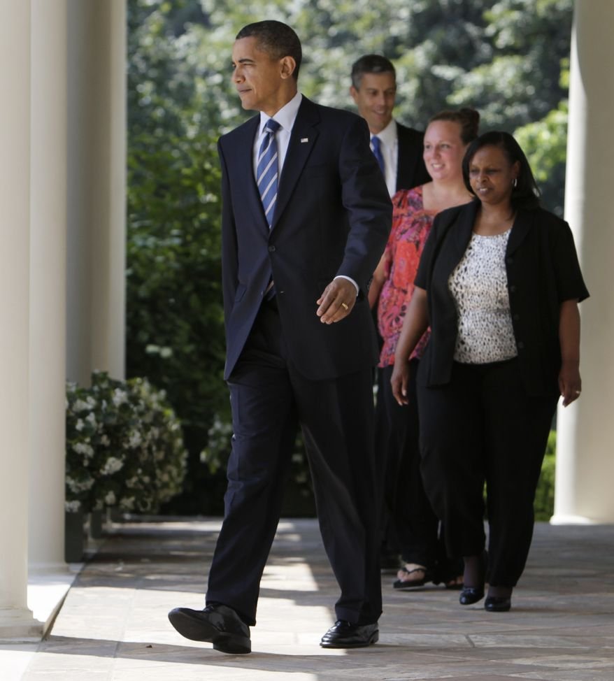 President Obama, followed by (from left) Education Secretary Arne Duncan and educators Rachel Martin and Shannon Lewis, walks to the Rose Garden at the White House in Washington, Tuesday, Aug. 10, 2010. (AP Photo/Carolyn Kaster)