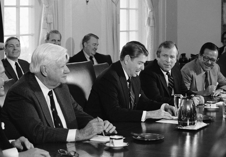 In this Jan. 25, 1984 file photo, President Ronald Reagan is flanked by Congressional leaders during a meeting in the Cabinet Room of the White House in Washington. From left are, House Speaker Thomas P. O'Neill; Chief of Staff James Baker, partly obscured; Attorney General Nominee Edwin Meese; President Reagan; Majority Leader Howard Baker; and Majority Whip Ted Stevens of Alaska. Stevens, an uncompromising advocate for Alaska for four decades who delivered scores of expensive projects to one of the nation's most sparsely populated states, died in a plane crash on Monday, Aug. 9, 2010 at the age of 86. Family spokesman Mitch Rose says Stevens was among the victims of a crash outside Dillingham, Alaska about 325 miles southwest of Anchorage. (AP Photo/Barry Thumma, File)
