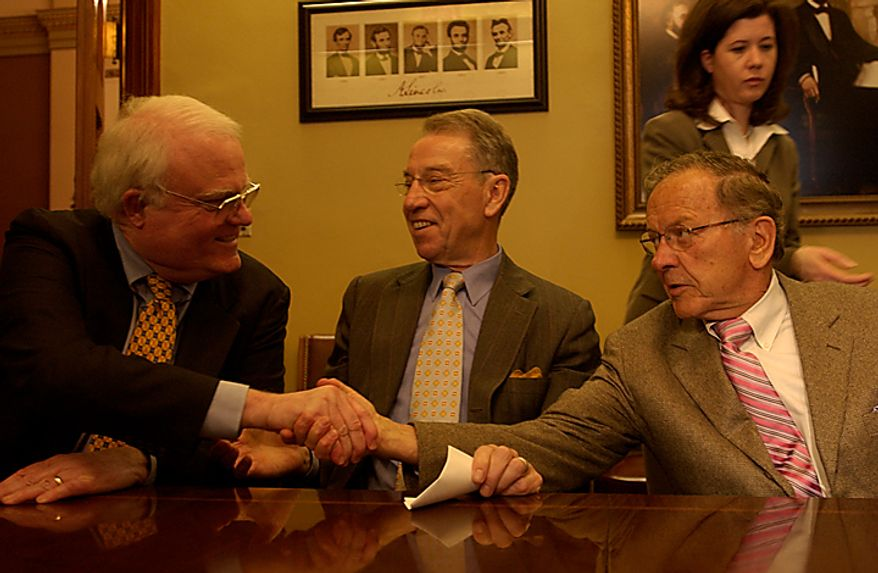 Legislators convene in the offices of House Speaker Dennis Hastert in the U.S. Capitol to sign legislation regulating personal bankruptcy, Thursday, April 14, 2005. Rep. James Sensenbrenner (R-WI), left, reaches across Senator Chuck Grassley (R-IA) to shake hands with Senator Ted Stevens (R-AK), after the signing. (Allison Shelley / Washington Times)