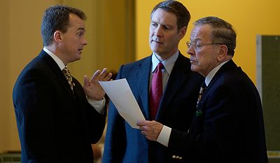 In the hallway outside the Senate Chamber on Capitol Hill. Sen. Ted Stevens, R-Alaska, right, Dave Schiappa, center, and Senate Majotity Leader Bill Frist of Tenn. discuss their next move after a cloture vote failed. Wednesday, December 21, 2005. ( Daniel Rosenbaum / Washington Times )