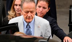 ** FILE ** Sen. Ted Stevens, Alaska Republican, leaves U.S. District Court in Washington on Thursday, July 31, 2008, after pleading not guilty to seven counts, including concealing more than $250,000 in gifts from an oil services company. (The Washington Times)