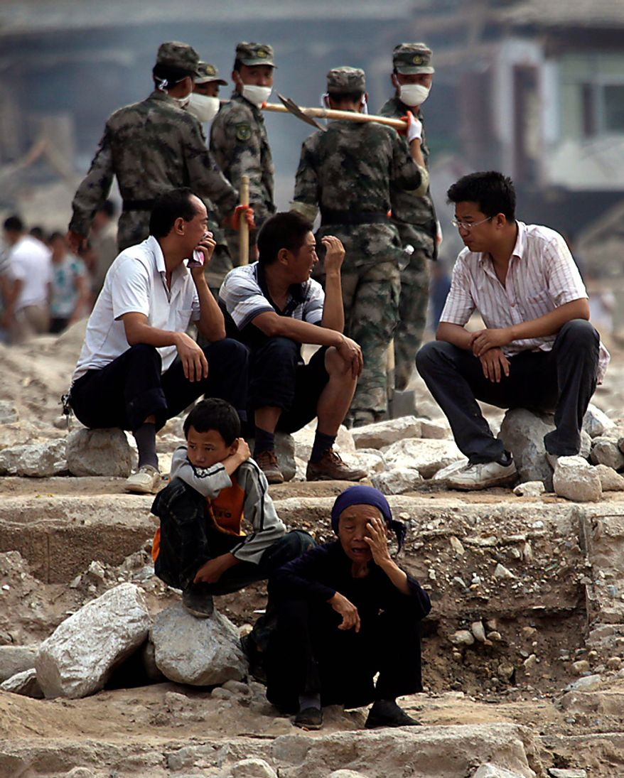 Chinese residents grieve after a mudslide swept through the town of Zhouqu in Gannan prefecture of northwestern China's Gansu province, Tuesday, Aug. 10, 2010. Rescuers in three countries across Asia struggled Tuesday to reach survivors from massive flooding that has afflicted millions of people, as the death toll climbed in the remote Chinese town where hundreds died and more than 1,100 were missing from landslides. (AP Photo/Ng Han Guan)