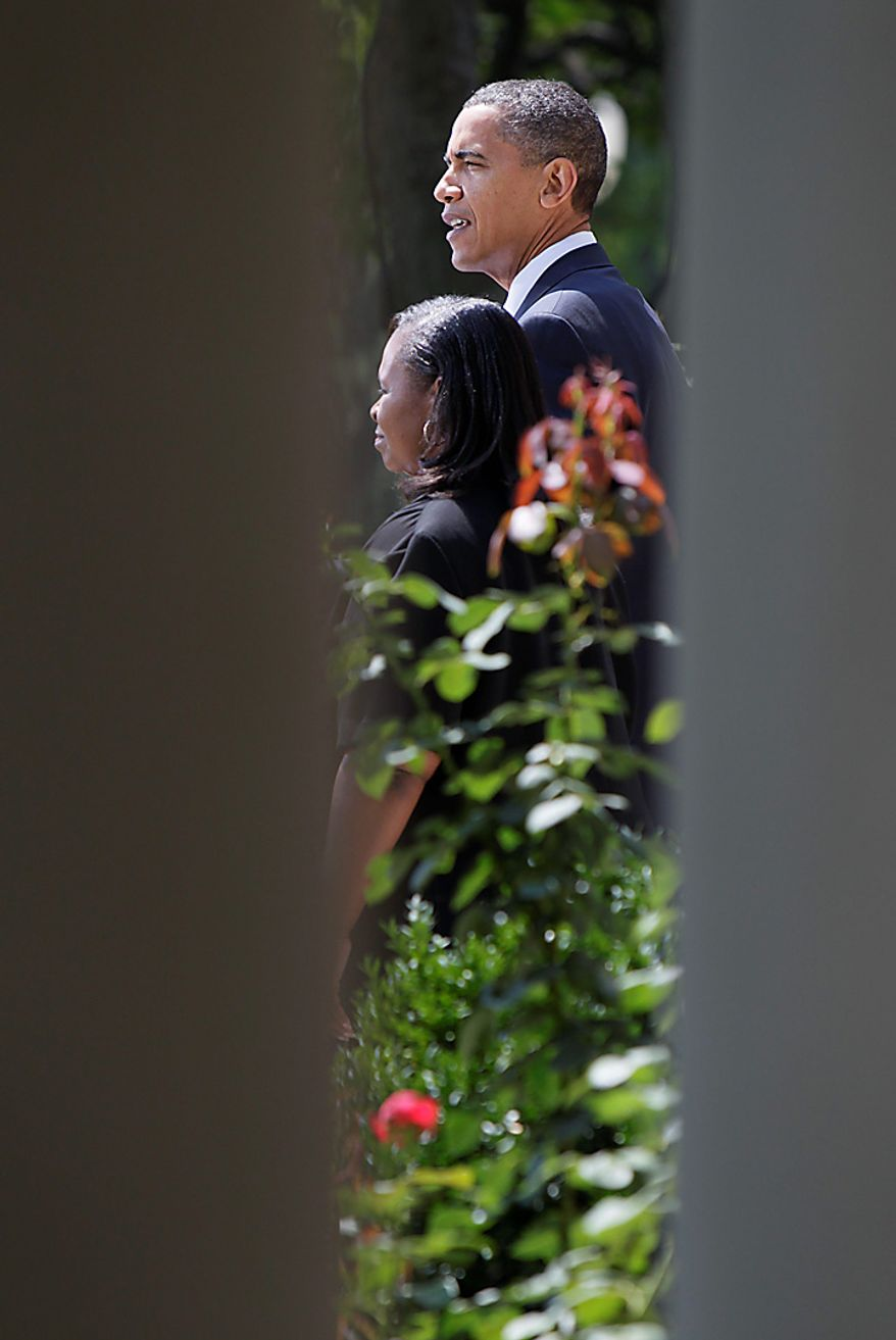 President Barack Obama speaks about teacher jobs, Tuesday, Aug. 10, 2010, in the Rose Garden of the White House in Washington. Educator Rachel Martin is in the foreground. (AP Photo/Carolyn Kaster)