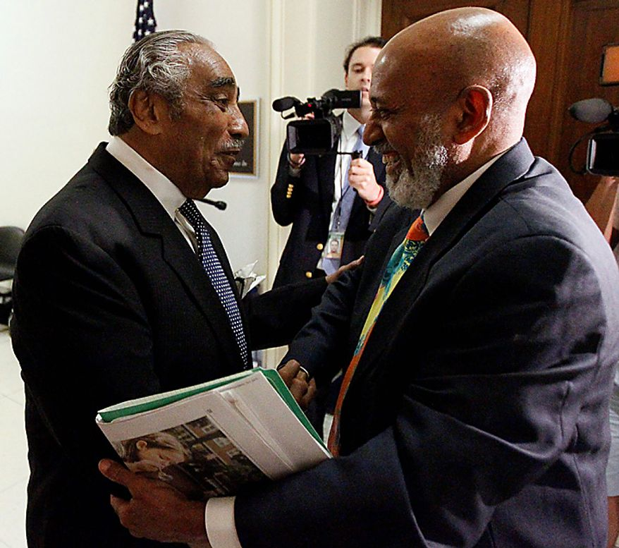 Rep. Charles Rangel, D-N.Y., left, talks with Rep. Alcee Hastings, D-Fla., as he walks into his office on Capitol Hill in Washington, Tuesday, Aug. 10, 2010. (AP Photo/Alex Brandon)