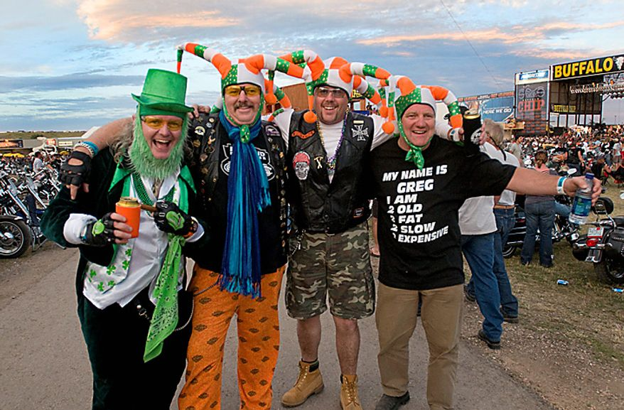 From the left, Martin Lecane, 45, John Lecane, 55, David Hayes, 38, and Greg Cullagh, 48, from Cork City, Ireland, attend the Buffalo Chip Campground concert as they attend the Sturgis Motorcycle Rally in Sturgis, S.D., Monday Aug. 9, 2010.    (AP Photo/Steve McEnroe)