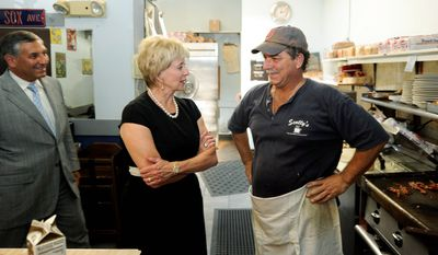 Linda McMahon chats with Scotty's Diner owner Scotty Vincent as she campaigns in North Haven, Conn., on Wednesday, the day after winning the Republican U.S. Senate nomination in Connecticut. (AP Photo)